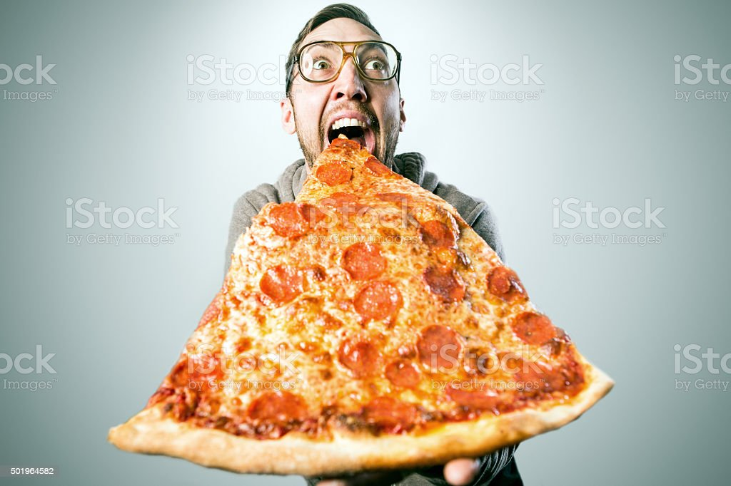 Man Eating Oversized Pizza Slice stock photo