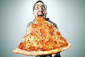 Man Eating Oversized Pizza Slice