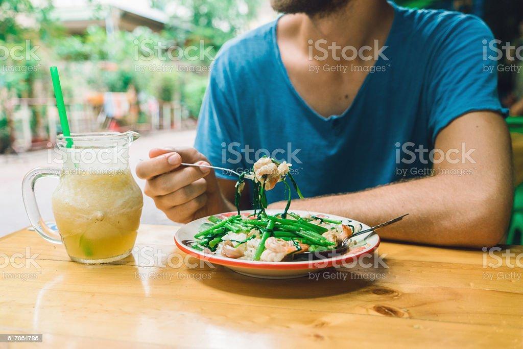 Man eating rice  in cafe in Bangkok stock photo