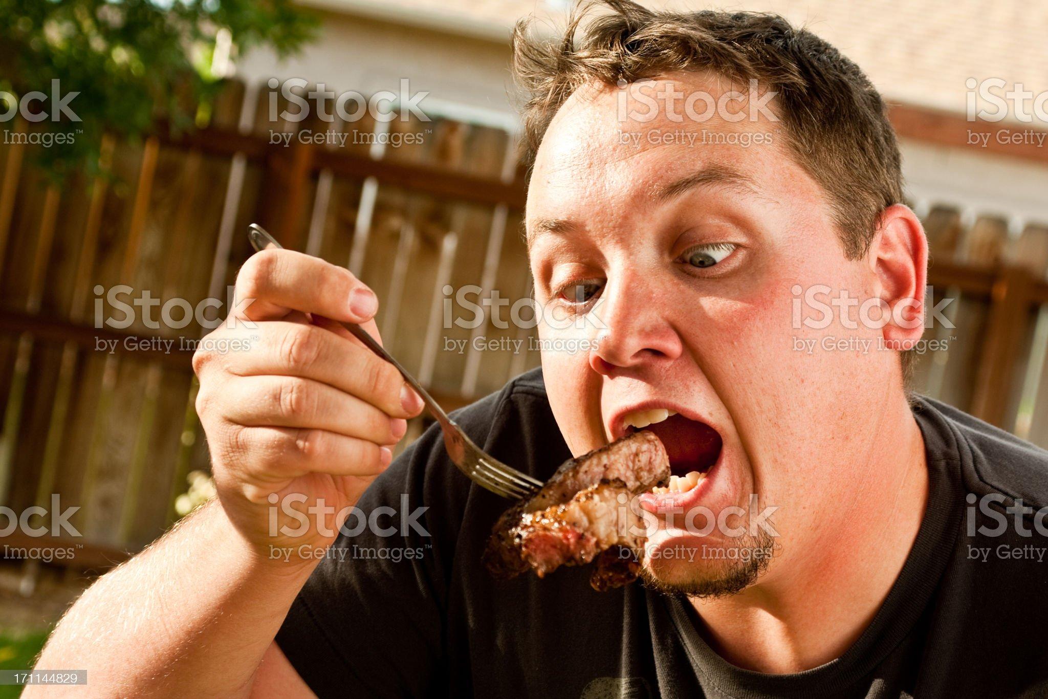 Man Eating Steak royalty-free stock photo