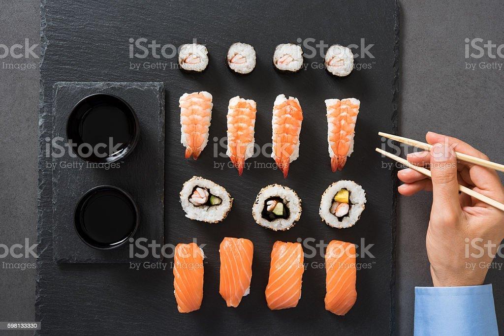 Man eating sushi stock photo