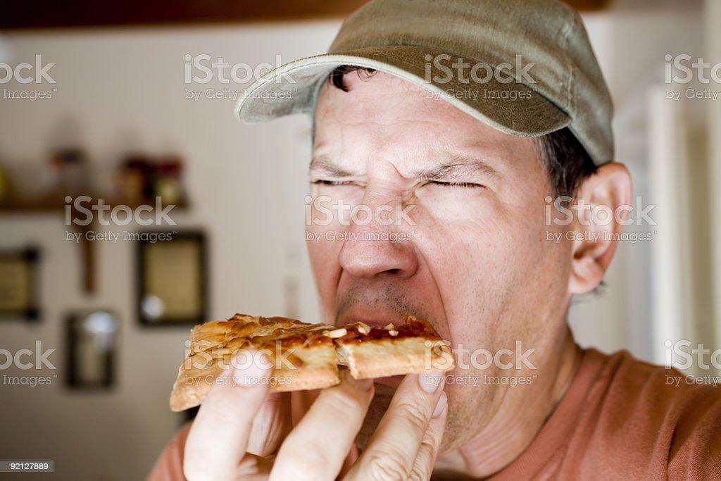 Man Eating Yucky Pepperoni Pizza stock photo