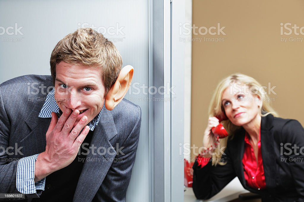 Man Eavesdropping Outside Office stock photo