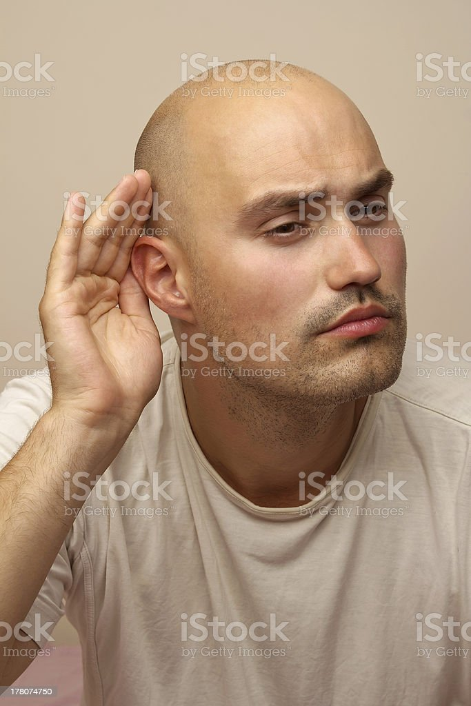 Man eavesdropping royalty-free stock photo
