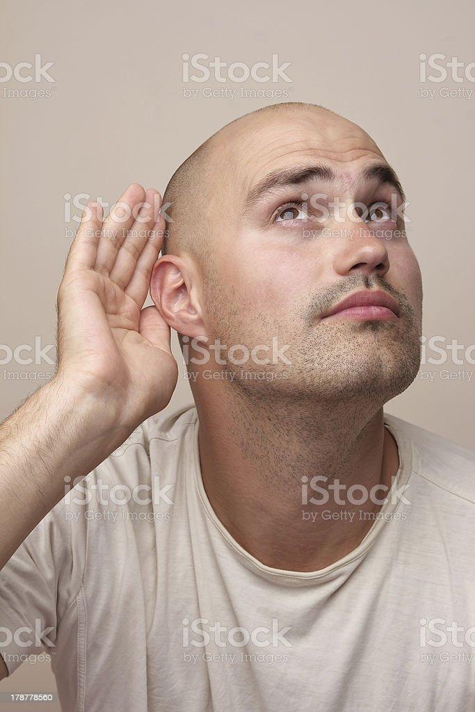 Man eavesdropping stock photo