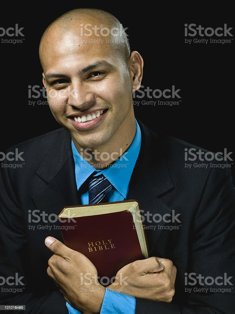 Man embracing his bible stock photo