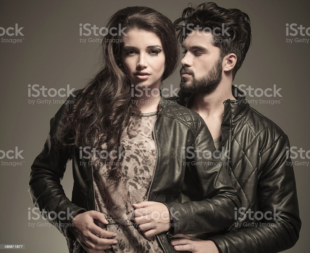 man  embracing his woman from behind stock photo