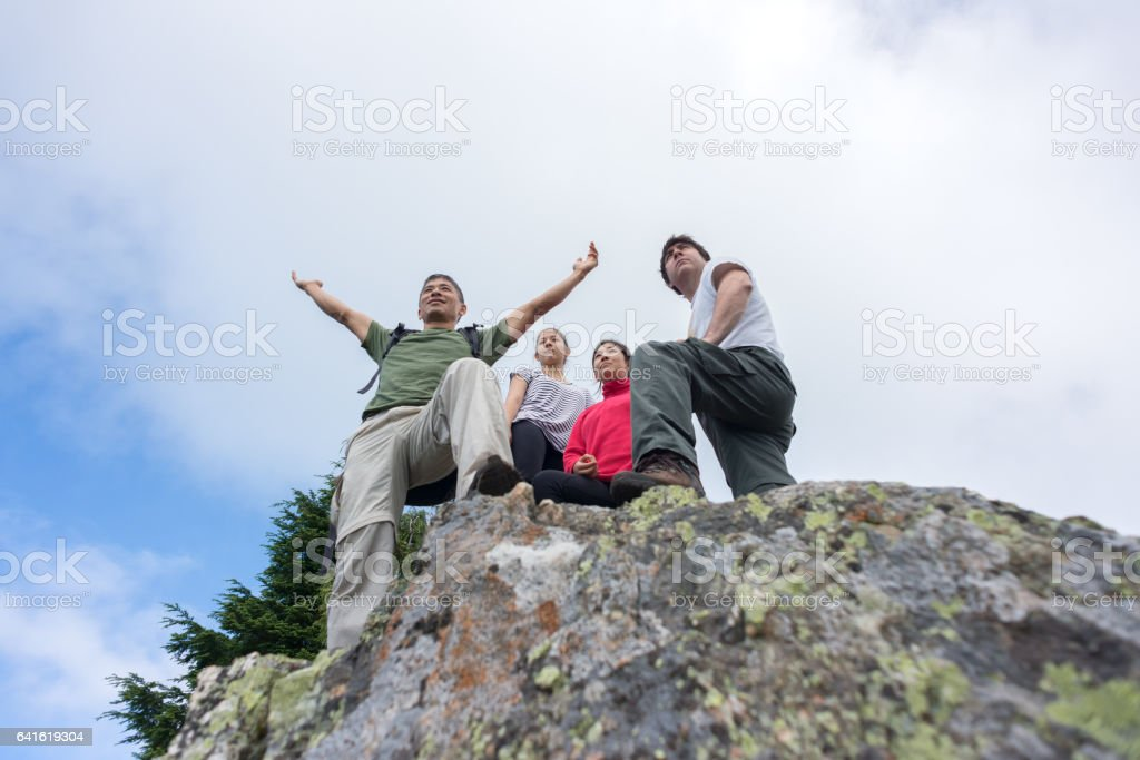 Man Embracing Nature with Open Arms Enjoying View with Familiy stock photo