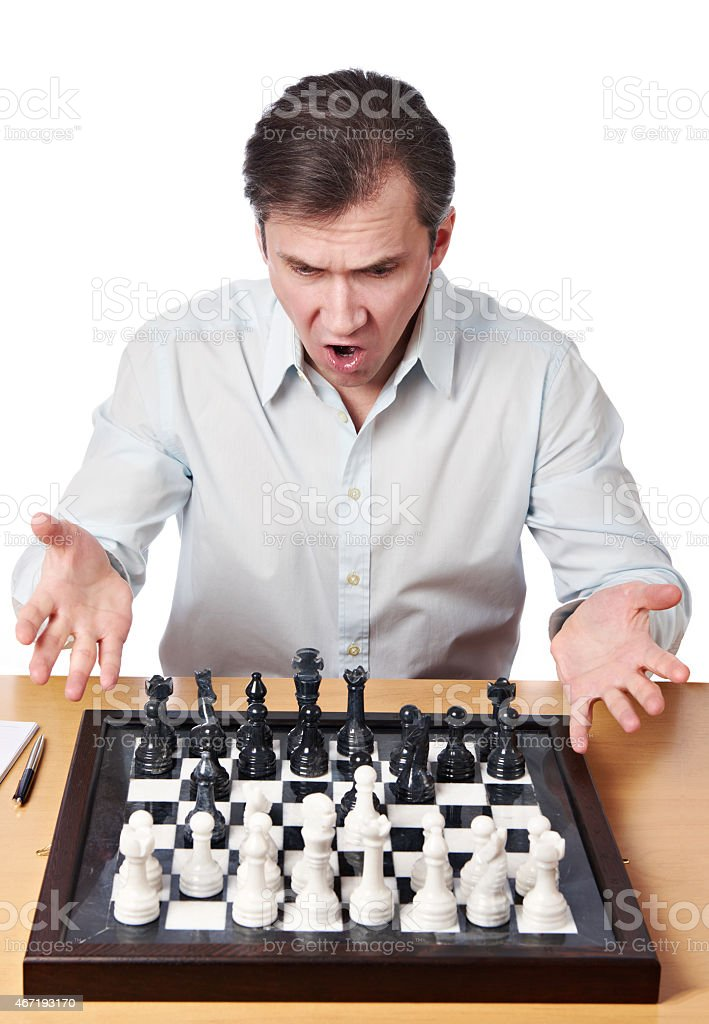 Man emotionally perturbed game combination in chess stock photo