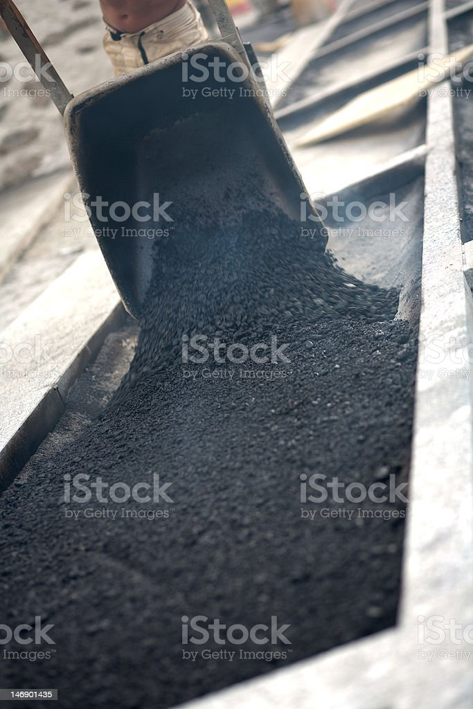 Man empty asphalt wheelbarrow stock photo
