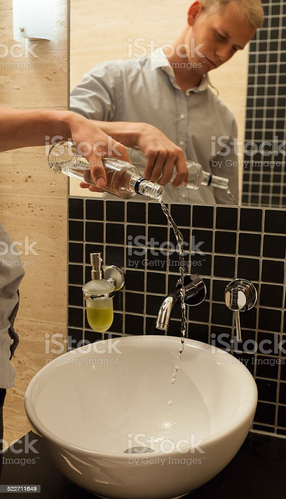 Man ending with alcohol stock photo