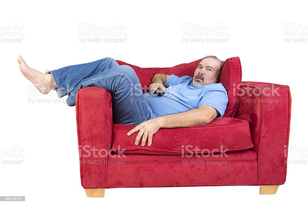 Man engrossed in watching television stock photo
