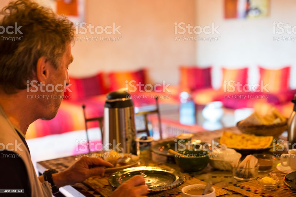 Man Enjoying Breakfast in Riad, Morocco, Africa stock photo