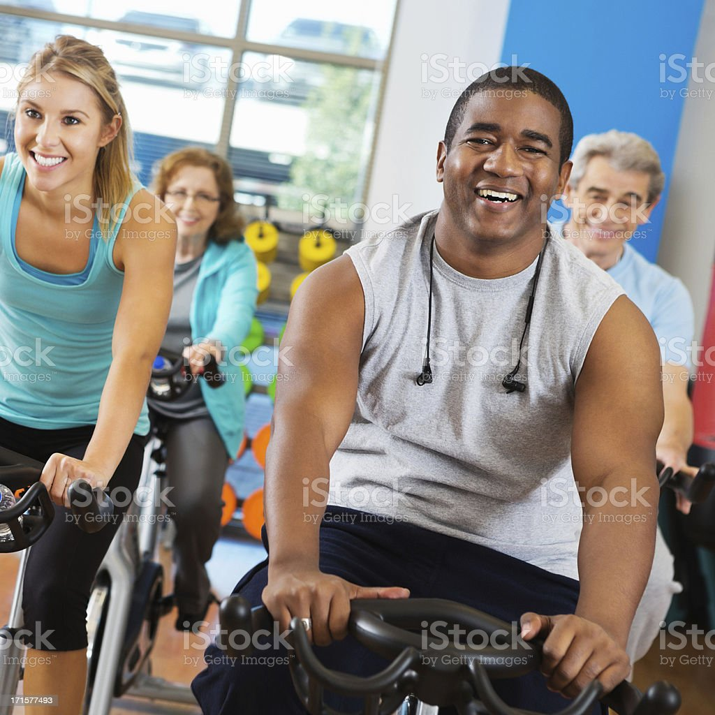 Man enjoying cycling in his workout class royalty-free stock photo