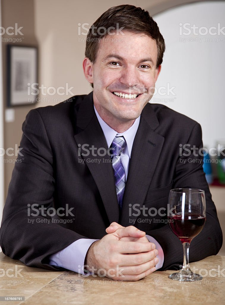Man enjoying Glass of Wine in a Bar stock photo
