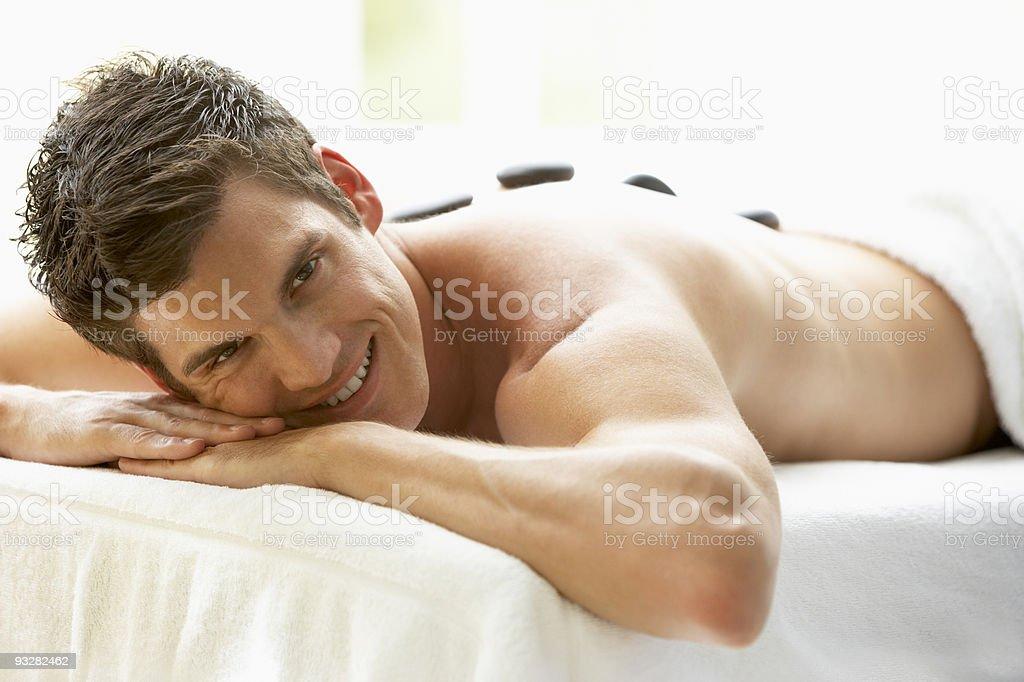 Man Enjoying Hot Stone Treatment royalty-free stock photo