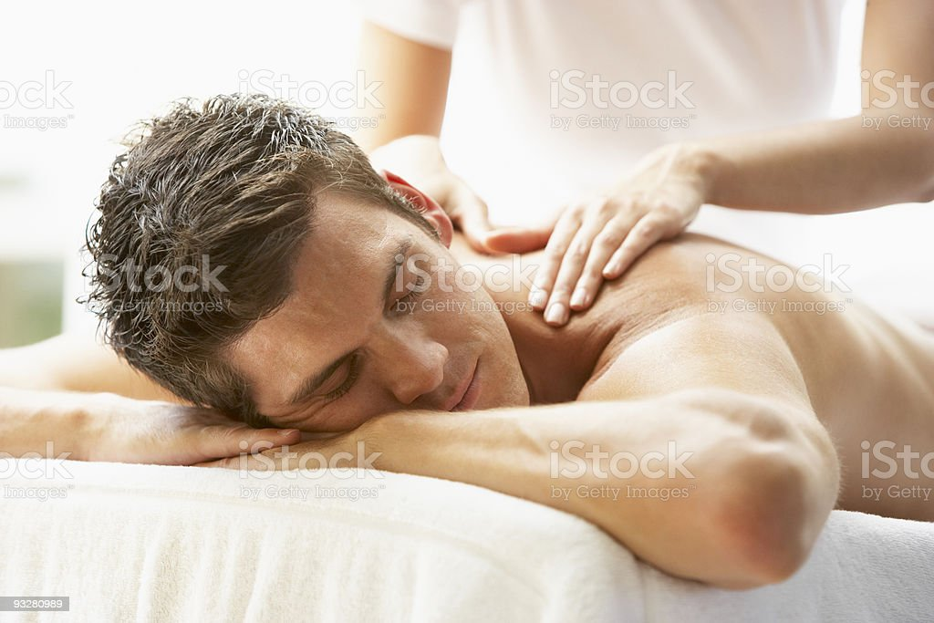 Man Enjoying Massage At Spa stock photo