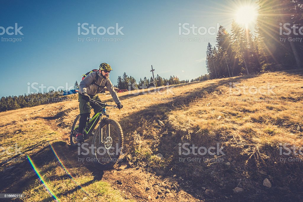 Man enjoying mountain biking stock photo