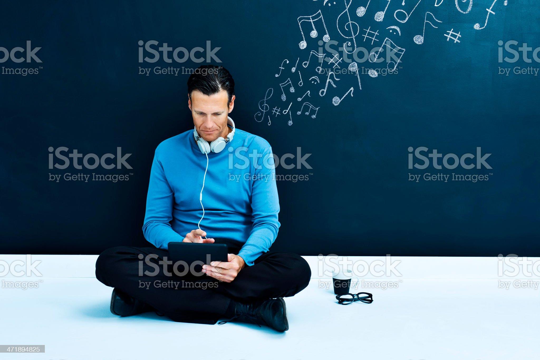 Man enjoying music on tablet royalty-free stock photo