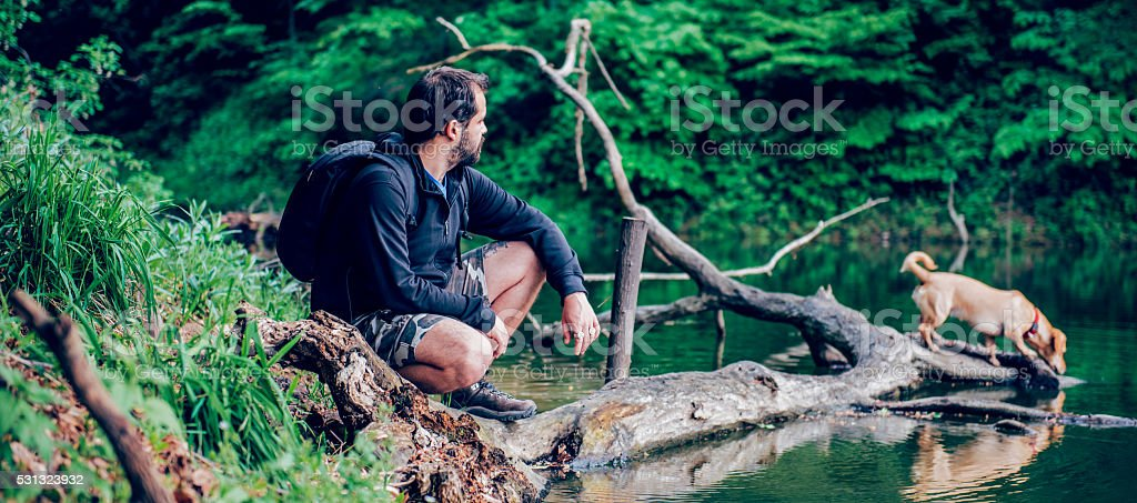 Man enjoying nature with the dog stock photo