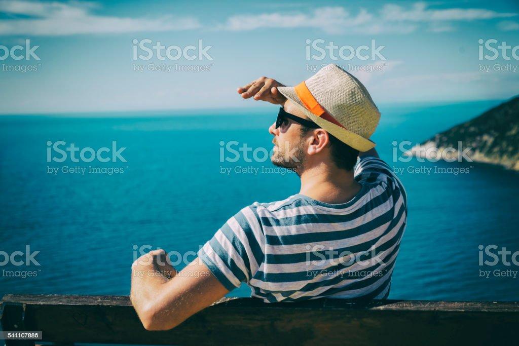 Man enjoying on the beach. stock photo