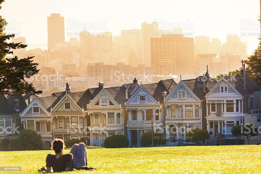 Man Enjoying San Francisco View in Alamo Square at Sunset stock photo