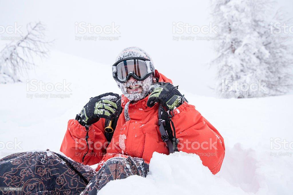 Man enjoying ski holiday stock photo