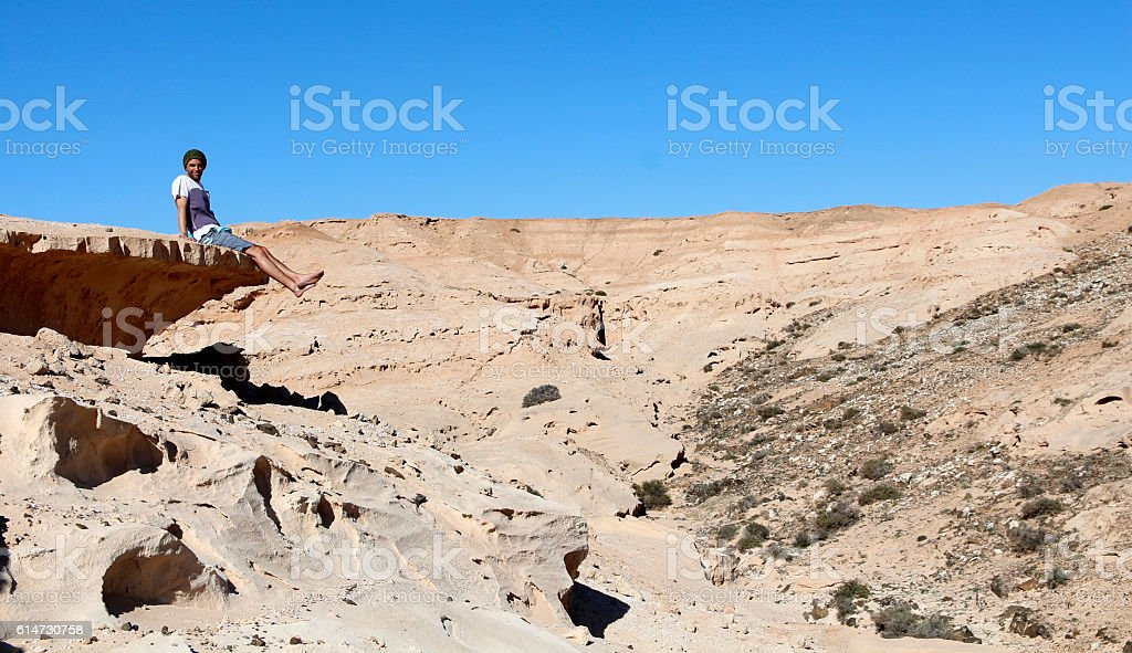 Man enjoying the view of Fuerteventura landscape stock photo