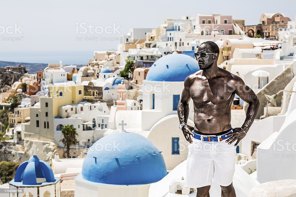 Man enjoying vacations in Oia village, Santorini island stock photo