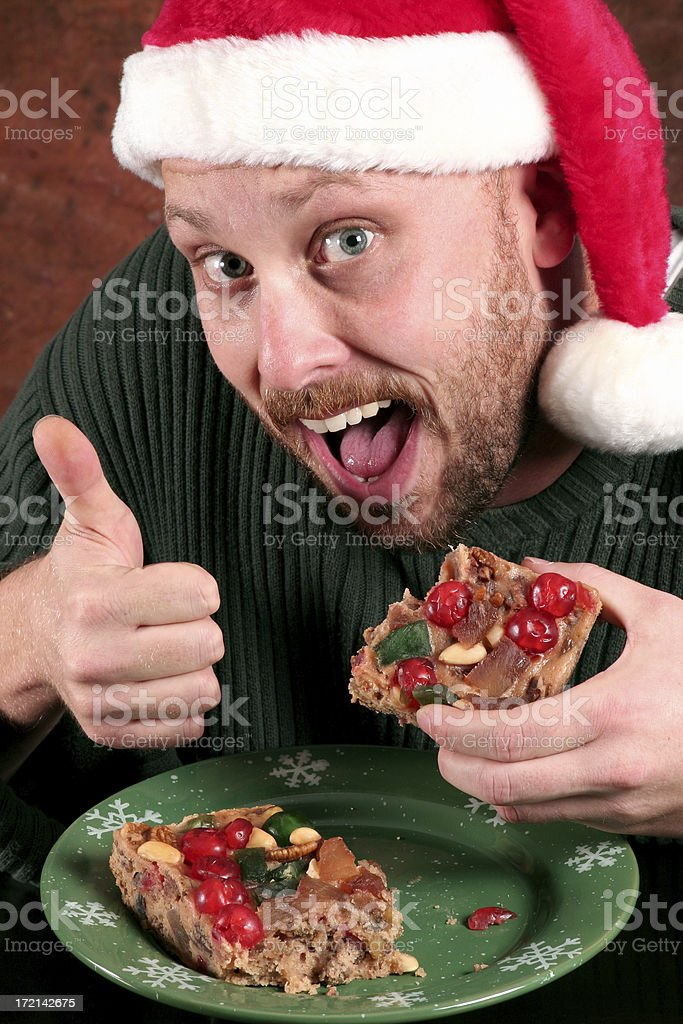 Man enjoys Fruitcake royalty-free stock photo