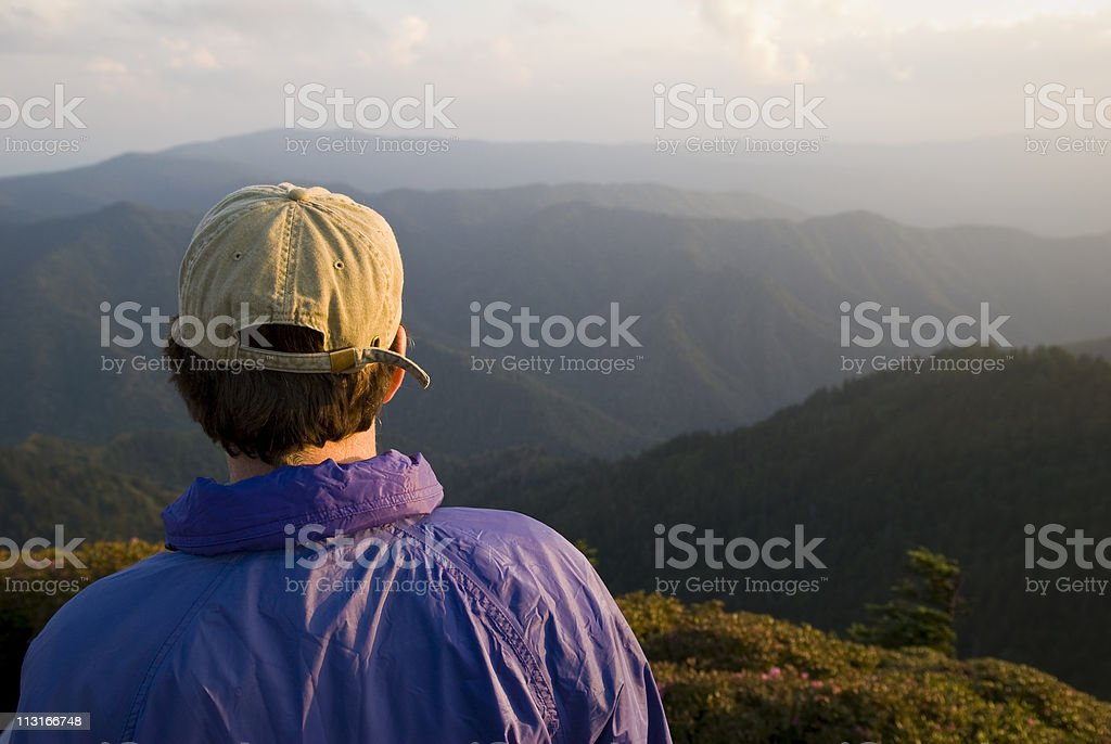 Man with aspirations looking at mountains royalty-free stock photo