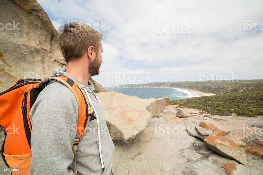 Man enjoys view from rocks stock photo