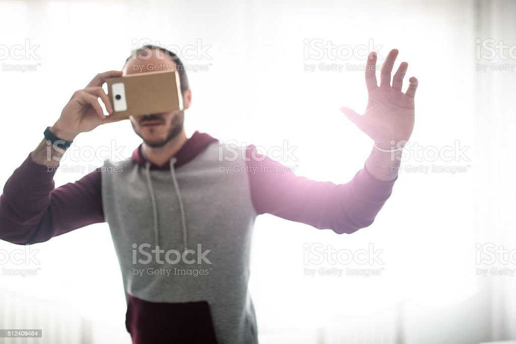 man entartains his self with virtual reality device simulator stock photo