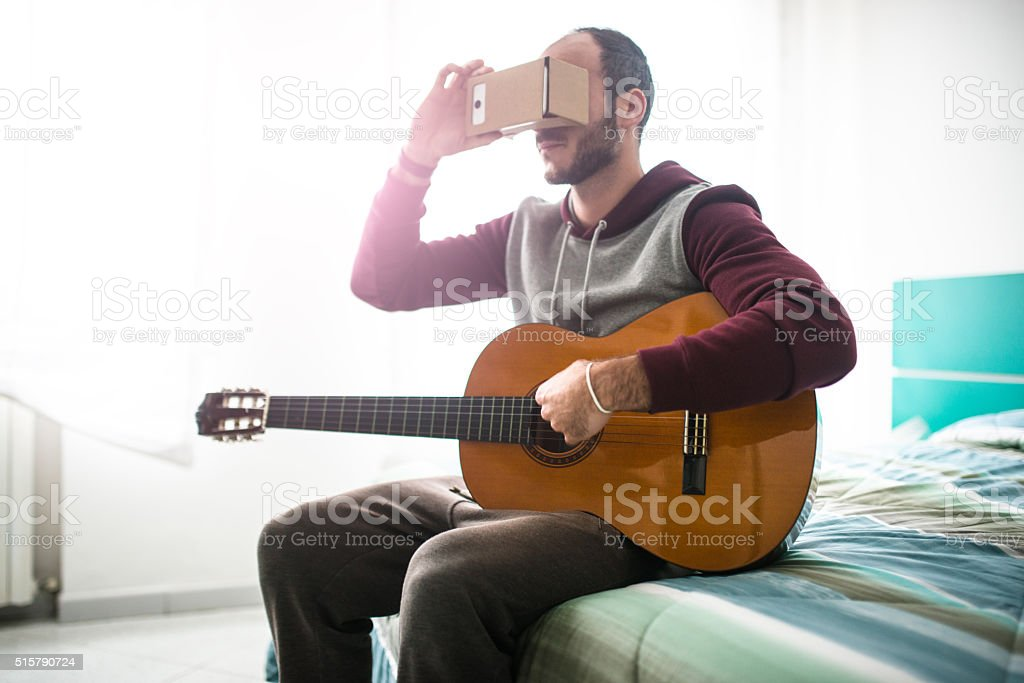 man entartains his self with virtual reality device simulator stock photo
