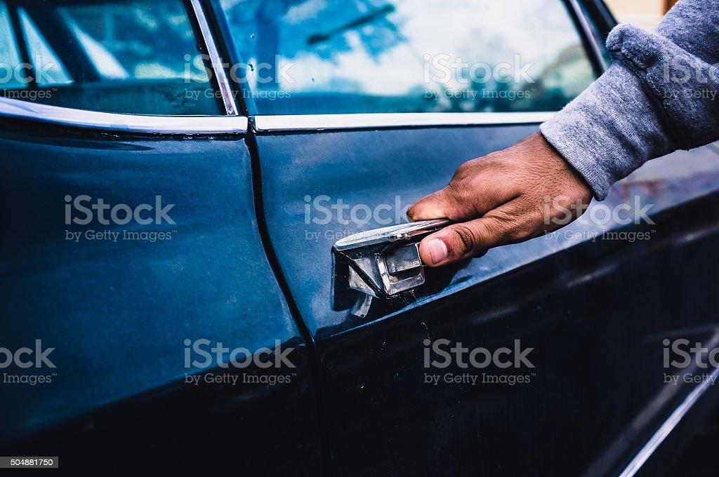 Man entering into a car stock photo
