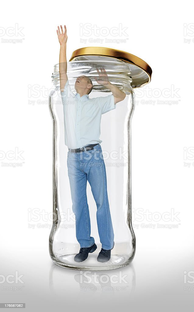 Man Escapes from a Glass Jar royalty-free stock photo