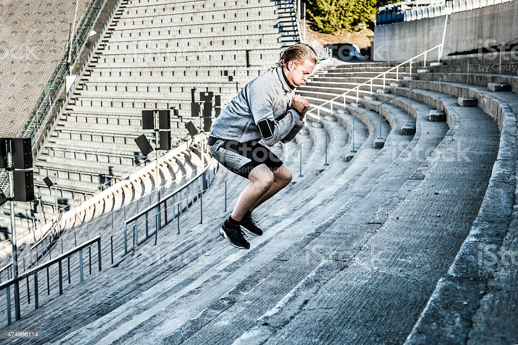 Man excercising in the city using urban structures stock photo