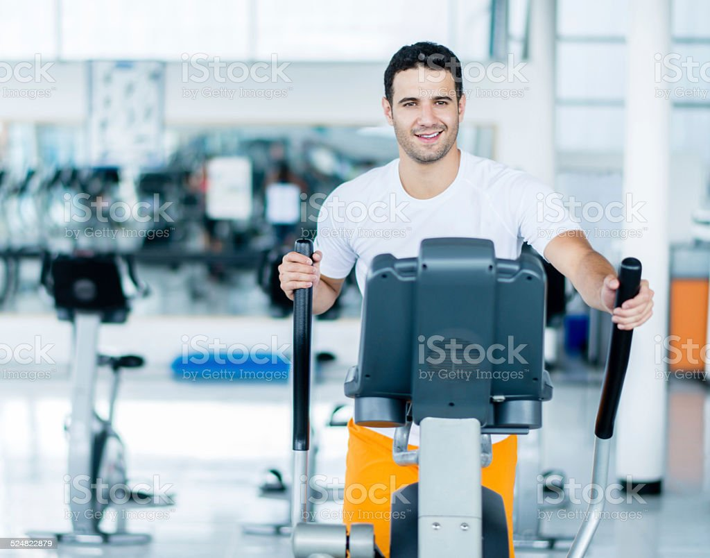 Man exercing on cross trainer stock photo