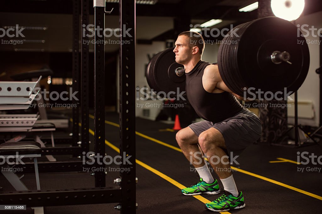 Man exercise at the gym stock photo
