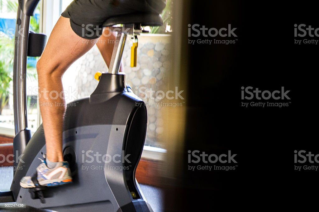 Man exercise cycling stock photo