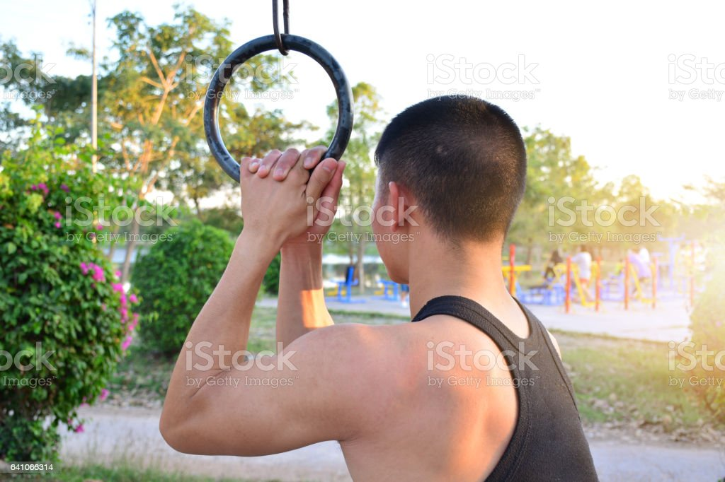 Man exercise in public park for health, slim build muscle stock photo
