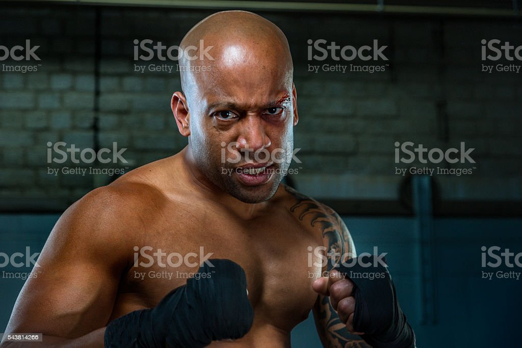 man exercising and fighting in boxing gym stock photo