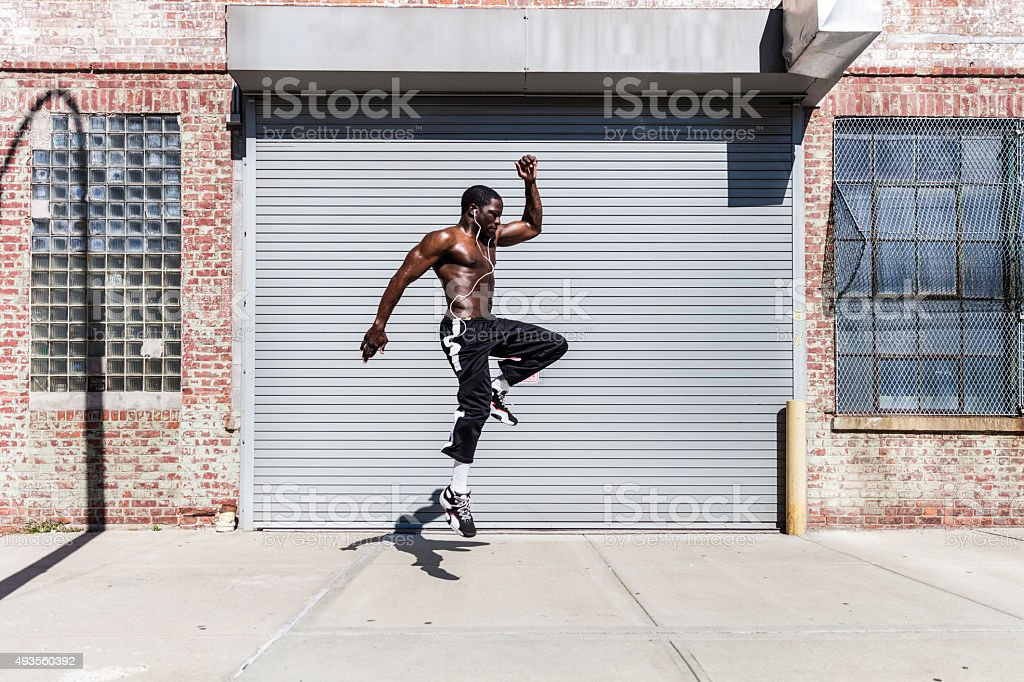 Man exercising and jumping in Queens streets - NY stock photo