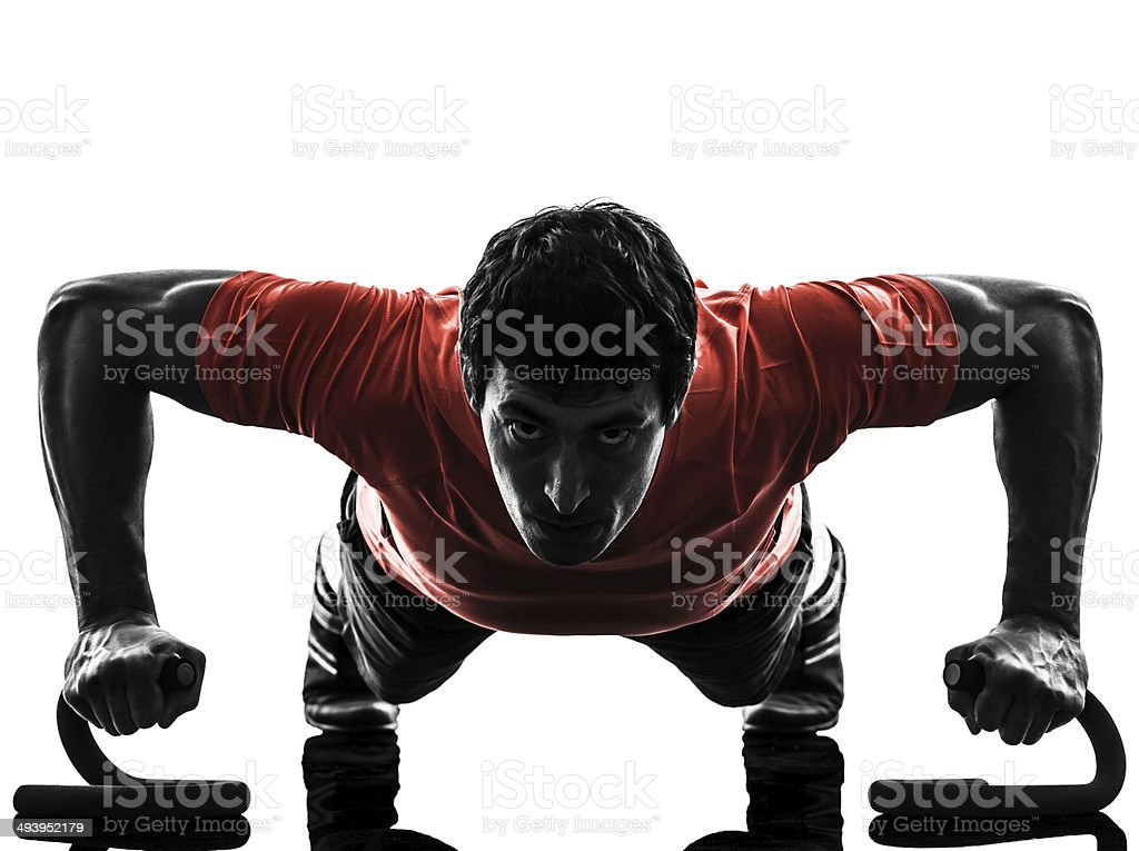 man exercising fitness workout push ups silhouette stock photo
