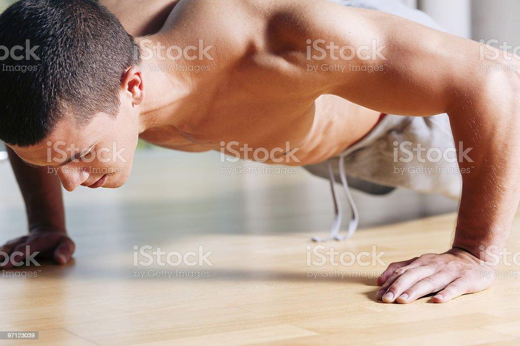 Man exercising  in gym - push ups royalty-free stock photo