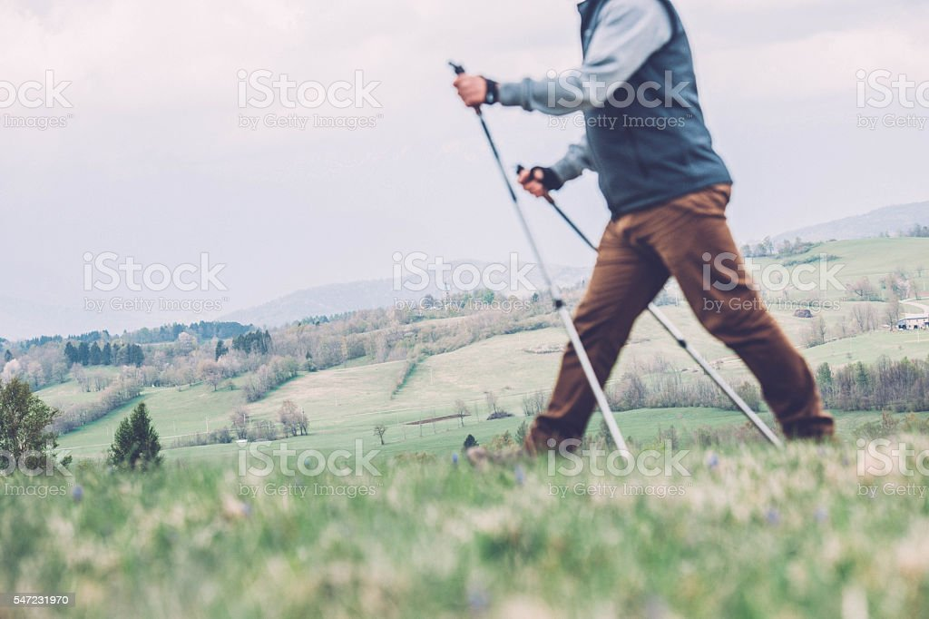 Man exercising Nordic walking technique - blurred shape in motion stock photo
