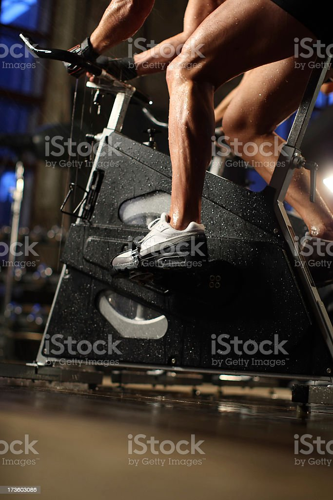 Man exercising on a bicycle in the gym royalty-free stock photo