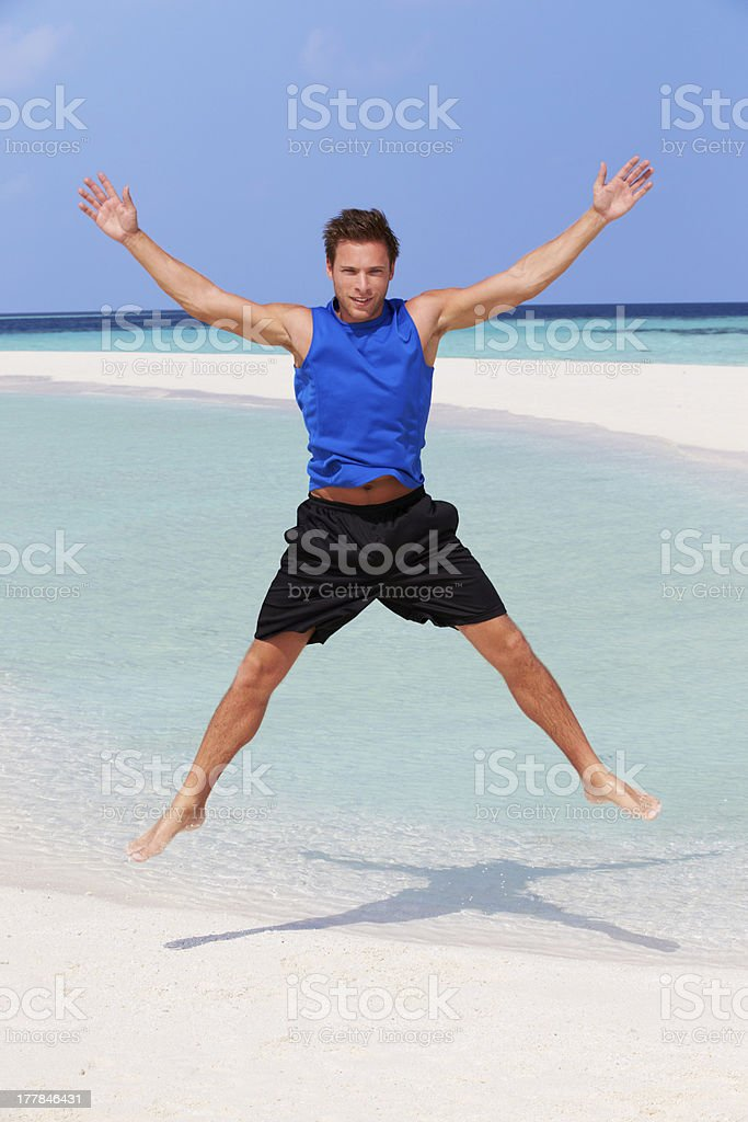 Man Exercising On Beautiful Beach stock photo