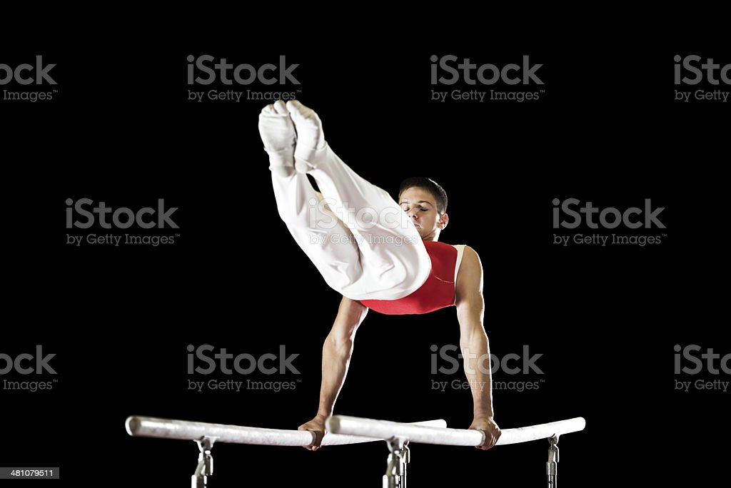 Man exercising on parallel bars. stock photo