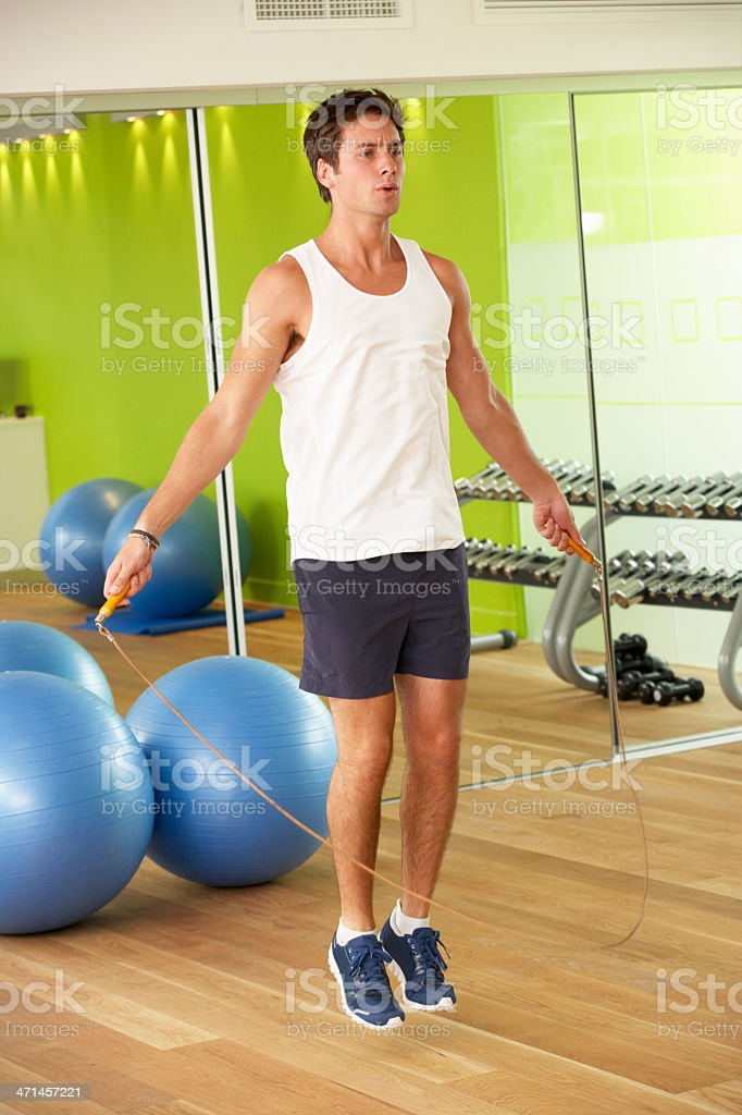 Man Exercising With Skipping Rope In Gym royalty-free stock photo